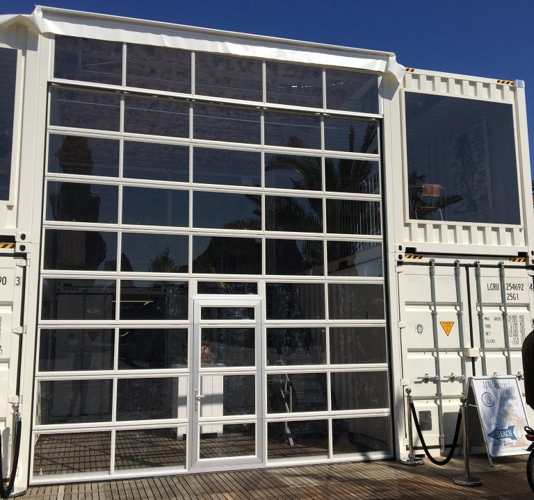 Compact folding door in temporary building