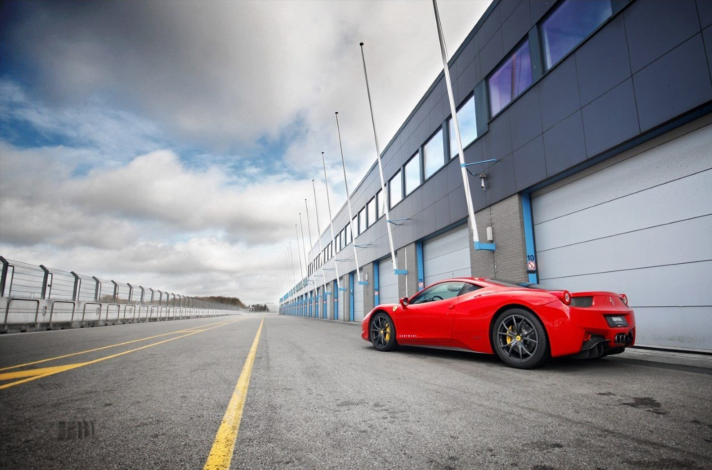 Compact industrial garage doors in the pitlane of TT racetrack