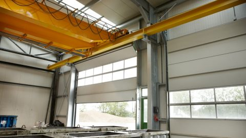 Crane track directly behind folding door